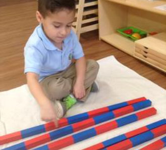 young boy playing blocks